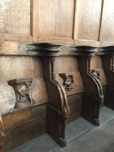 Carved benches in Oude Kerk